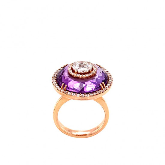 A wide gold ring studded with diamonds with an Amatyst stone